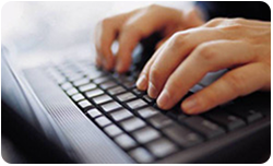 Picture of fingers typing on laptop keyboard